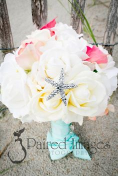 beautiful beach wedding bouquet with starfish pin
