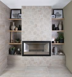 Make a stylish addition to your home décor with a feature wall. Cut décor tiles and mosaics are ideal for this particularly around a built-in fireplace and can really bring your unique sense of style into the space. Trendy Home, Design Trends, Bookcase, Tiles, New Homes, Feature Walls, Shelves, Flooring, Living Room