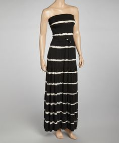 Look marvelous in a maxi. Serious stripes add style to this billowing, strapless piece.
