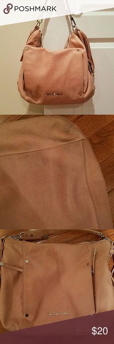 Michael Kora handbag MK handbag darkening shading  of leather on side the rubbed up against clothing  many compartments in this handbag pink/blush color Michael Kors Bags Shoulder Bags
