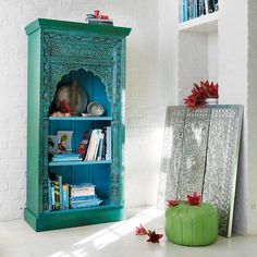 the Madras bookcase.Made from recycled wood and mango wood, this blue bookcase will add warmth to your décor.