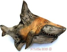 """""""Pine Shark"""" 7½ inches long, 6 inches at his tallest fin. This little man eater is carved on one side only. Signed and dated: N. Tuttle 6/27/15"""