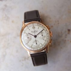 A gorgeous example of an original Breiling chronograph from 1945. Original features include: Champagne dial gracefully evenly age patina; ref. 787 manual movement with 18,000 bph, 17 jewels, caliber Venus 178, the 18ct rose gold case is well preserved, 35mm case. We have replaced the strap with a dark brown leather strap. This handsome vintage watch runs very well, holds a good charge and keeps very good time. This is one to keep in your … Read More →