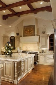 White Kitchen high ceiling with wood beams
