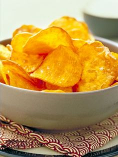 Baked sweet potato chips: Thinly slice the potatoes, lay on a baking sheet so they don't overlap, brush with oil and sprinkle a little salt. Bake at 400 degrees F for about 15 minutes.