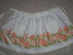up cycling vintage linens to design vintage inspired aprons, crafts, repurposing upcycling, Orange roses on linen Cross stitch pocket detail Vintage buttons on waistband Hand sewn