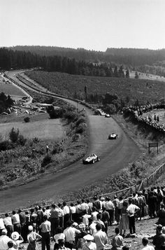 Race won by Juan Manuel Fangio (Officine Alfieri Maserati) followed by Mike Hawthorn (Scuderia Ferrari) and Peter Collins (Scuderia Ferrari).  1957 German Grand Prix, Nürburgring Nordschleife