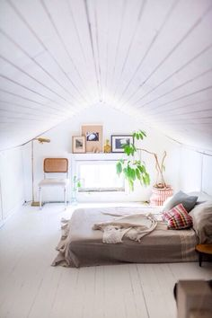 Low Ceiling Bedroom - but it doesn't feel cramped! I think the key is the all white decor and color motif