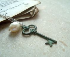 A personal favorite from my Etsy shop https://www.etsy.com/listing/193952952/patina-key-necklace-freshwater-pearl