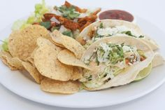 Grilled Chili Lime Chicken Street Tacos Queso cotija, cabbage, onion, cilantro, chili crème. Served with chili lime Caesar salad,  tortilla chips and roasted tomato salsa. @Crocker Art Museum Cafe