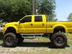 Own a lifted yellow truck