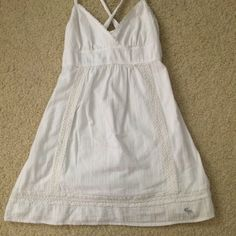 SALE White summer dress from Abercrombie Very cute white spring/summer mini dress from Abercrombie! Size XL in kids, would fit XS/S in adults. 100% cotton, lined, no stains or flaws. Criss-cross straps in back, elastic around top in back, too. Lace trim around bottom and lining the sides. Abercrombie & Fitch Dresses Mini