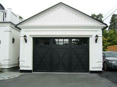 Did you remember to shut the garage door? Most smart garage door openers tell you if it's open or shut no matter where you are. A new garage door can boost your curb appeal and the value of your home. Farmhouse Garage, Custom Built Homes, House Exterior, Carriage Garage Doors, New Homes, Garage House, Modern Farmhouse, Garage Door Design, Garage Door Types