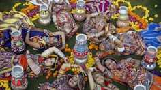 Indians girls, wearing traditional attire, pose for photographs as they practice Garba, the traditional dance of Gujarat state ahead of Hindu festival Navratri in Ahmadabad, India, Sunday, Oct. 11, 2015. Navratri or nine nights festival will begin from Oct. 13. (AP Photo/Ajit Solanki)