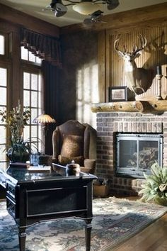 The Rivergate Custom Home - Home Office: A deer head, brick fireplace, and big panel windows make this custom home office rustic, yet regal. (Home Design & Decor by B.L. Rieke & Associates, Inc.) #luxuryhome #office #brickfireplace #rustic #dreamhome #customhome #homedesign Visit our website: http://www.blrieke.com/ Visit our #Houzz page: http://www.houzz.com/pro/blrieke/