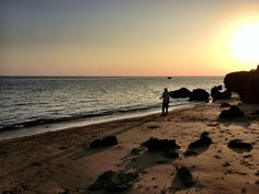A fisherman casts off into the East China Sea on Iriomote Island, Okinawa. (c) GTH & Nathan DePetris
