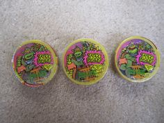 Teenage Mutant Ninja Turtles Tarts were fruit-flavored TMNT candies in small round cases, with rad artwork, & some very funky 90's graphic design. Not forgetting the tattoo! - I never really noticed the tattoo though! :P