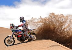 Spain's Gerard Farres Guell kicks up sand with his Aprilia during the 4th stage of the Dakar 2010 between Fiambala, Argentina, and Copiapo, Chile on January 5, 2010.