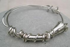 Handmade silver lilly bangle http://www.silverandstone.co.uk/html/silver_expanding_bangle_b31.html