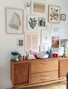 Art wall and a vintage cabinet, lovely mix of art and accessories