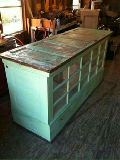 Easy island or kitchen buffet made out of old doors.