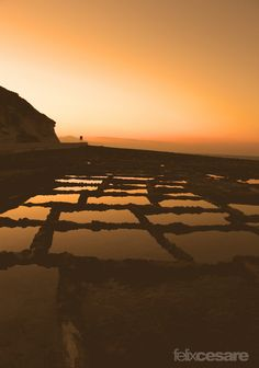 https://flic.kr/p/wPFbHA | Qbajjar Saltpans, Gozo Malta | On the north coast of Gozo, just past Qbajjar Bay west of Marsalforn, the coast is characterised by a chequerboard of rock-cut saltpans protruding into the sea.