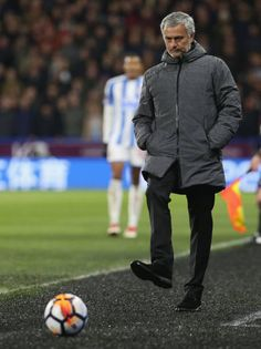 Manager Jose Mourinho of Manchester United controls the ball during the Emirates FA Cup Fifth Round match between Huddersfield Town and Manchester...