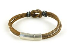 Unisex vegan leather bracelet, eco friendly Celtic infinity knot cork bracelet made from light brown Portuguese cork cord and quality metal cast Sterling silver Zamak hardware, Sterling jump rings, and rubber o rings. Hypoallergenic, certified lead and nickel free. Closes with a sleek,