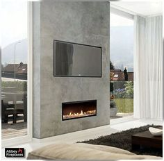 This is the gas fireplace! surrounded by polished concrete….  The Escea DX1000 inbuilt gas fireplace:
