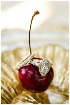 Beautiful pear shaped diamond engagement ring with diamond wedding band, image by Penni Lauren Photography.