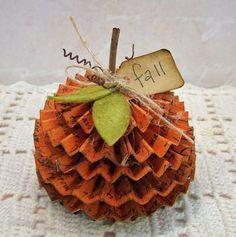 Folded paper pumpkin.  DIY Fall decor project