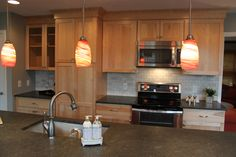 Transitional kitchen with red island