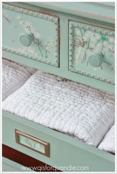 Wallpapered linen press dresser, painted in Annie Soan's Duck Egg.
