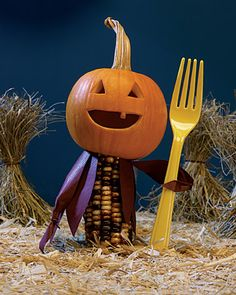 """Mini pumpkin scarecrow.  Love his """"pitchfork.""""  This would be cute as a garnish on a Halloween buffet table."""