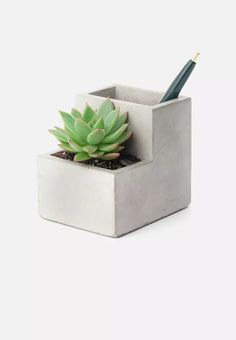 A dream for those looking to liven up their workspace, this desktop planter features two separate holders and has been crafted from concrete. Place your stationery in the one side, and succulents in the other.