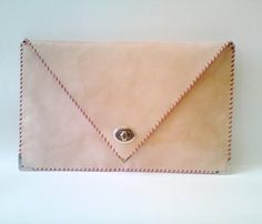 I like the brown leather - Handmade Leather Clutches