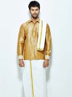 Delightful golden color raw silk shirt paired with white color cotton dhoti and angavastram. Item Code : SCU12002-9 http://www.bharatplaza.com/new-arrivals/south-indian-mens-wear.html
