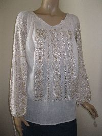 Delicate hand embroidered and hand sewn Romanian peasant blouse with ivory silk thread on pale beige gauze cotton .