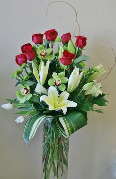 Romantically inspired flowers including roses orchids lilies and tulips. This is a custom arrangement of flowers by your local riverside ca florist - Willow Branch Florist of Riverside