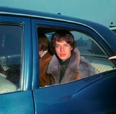 English pop singer Mick Jagger in a car after arrival with fellow Rolling Stones band members, Amsterdam, Netherlands, photograph by Nico van der Stam. Mick Jagger Rolling Stones, Los Rolling Stones, David Bowie, Lyon, El Rock And Roll, Moves Like Jagger, Charlie Watts, British Rock, Idole