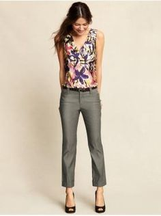 Bright patterned blouse, flattering dress capris, peep toes, and a skinny belt. Great look