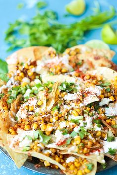 Mexican Street Corn Nachos – Damn Delicious Mexican Street Corn Nachos – Everyone's favorite Mexican elote is made into the BEST nachos! Loaded with roasted corn, lime, chili powder and Mexican crema! Mexican Dishes, Mexican Food Recipes, Dinner Recipes, Mexican Street Corn Salad, Mexican Nachos, Mexican Street Food, Mexican Appetizers, Mexican Entrees, Cooking Recipes
