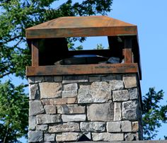 Metal chimney cap featuring a rustic finish. Stone Chimney, Chimney Cap, Metal Roof Houses, House Roof, Farm House, Backyard Fireplace, Modern Farmhouse Plans, Outdoor Fire, Architecture