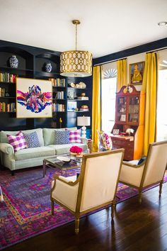 In this wildly colorful living room, /hisugarplum/ worked with designer /huntedinterior/ to create a glam, jewel-toned look while incorporating an antique secretary desk (a family heirloom), a traditional roll-arm sofa and Louis XVI-style chairs.
