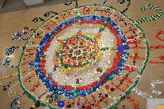 Temporary Mosaic/Mural with bottlecaps. Parking Lot or Playground in the spring. Sweep it up when done!!