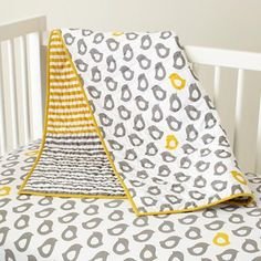 gray and yellow bedding