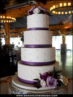 Wedding cake with purple fondant strips. www.swankcakedesign.com