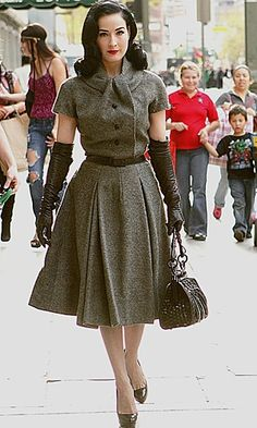 Dita von Teese's hourglass frame was made for 50s silhouttes. She looked fresh out of a timewarp in a vintage Dior suit dress as she headed out and about in LA, and no doubt had passers by in awe.