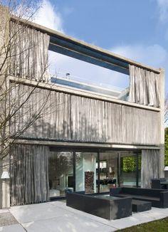 Villa Funken in Köln - Fassade aus Liapor Leichtbeton mit Stahlblechvorhängen von Artis Paas Architekten