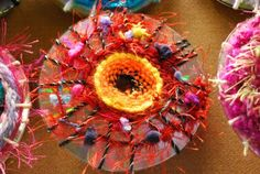 Yarn weaving on CD's! What a great way to upcycle.